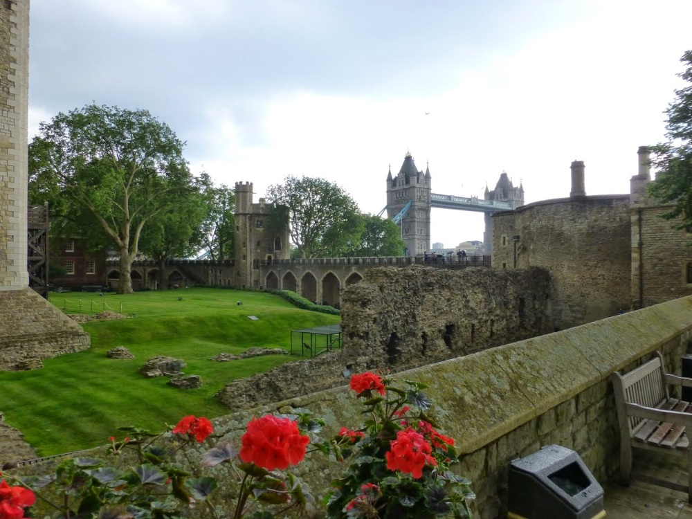 Red flowers, Tower of London, and London Bridge.